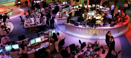 Staff work at the English-language newsroom at the headquarters of the Qatar-based Al Jazeera satellite channel in Doha