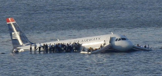 Passengers stand on the wings of a U.S. Airways plane as a ferry pulls up to it after it landed in the Hudson River in New York