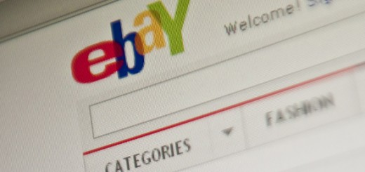 The eBay homepage appears on a screen in