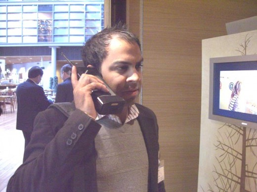 nihal on big cellphone 520x390 How New York Citys busiest CEO strikes a balance