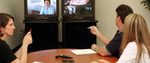 Polycom employees use videoconference system
