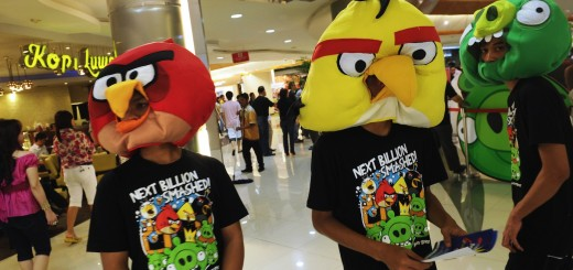 "Indonesian staff wear ""Angry Birds"" mask"