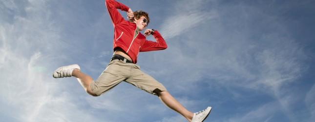 Teenage boy leaping in midair