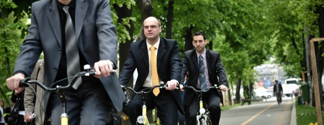 Businessmen take part in a cyclist event