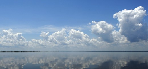 Clouds reflect on the Black River waters
