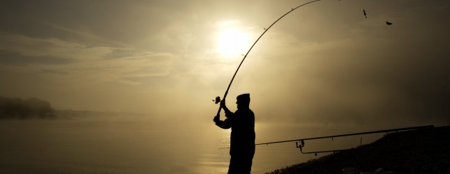 A sports fisherman tries his luck early