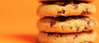 Close-up of chocolate chip cookies stacked high on top of each other