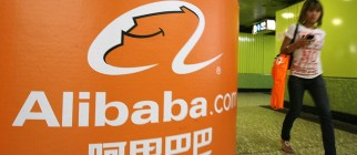 A pedestrian walks past Alibaba.com adve