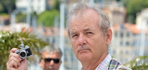 US actor Bill Murray holds a small camer